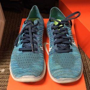 Blue Nike Free Run Flyknits